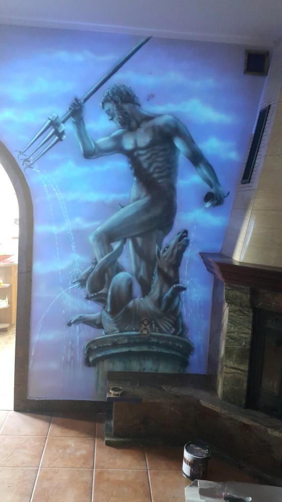 Malowanie świecącego grafitii na ścianie neptun Gdański