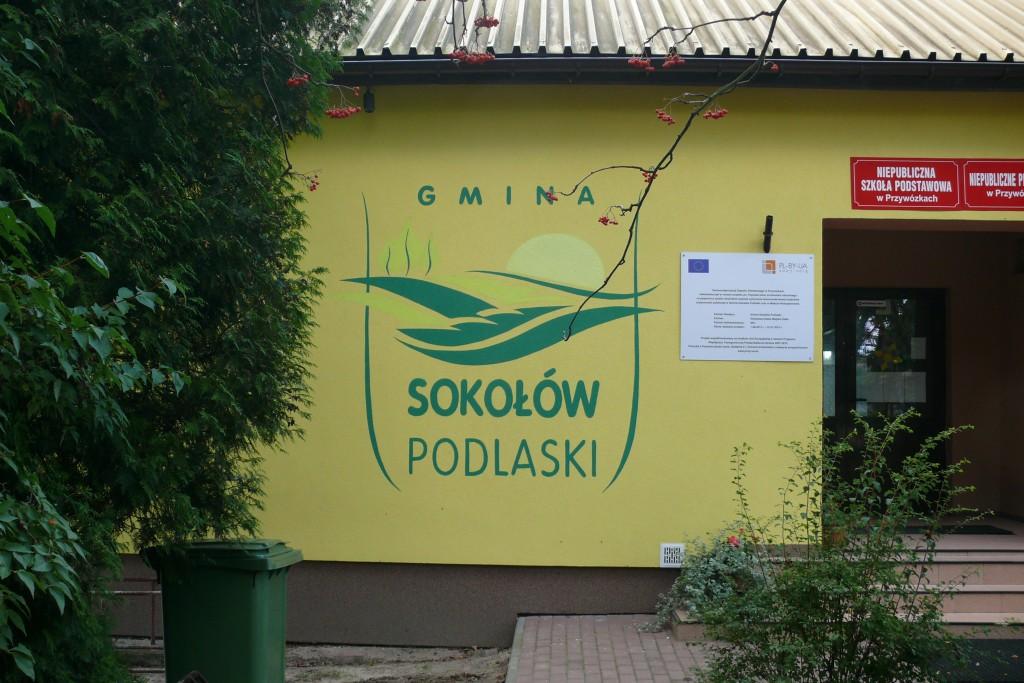 Malowanie logotypów na elewacji budynku, logo malowane dla gminy