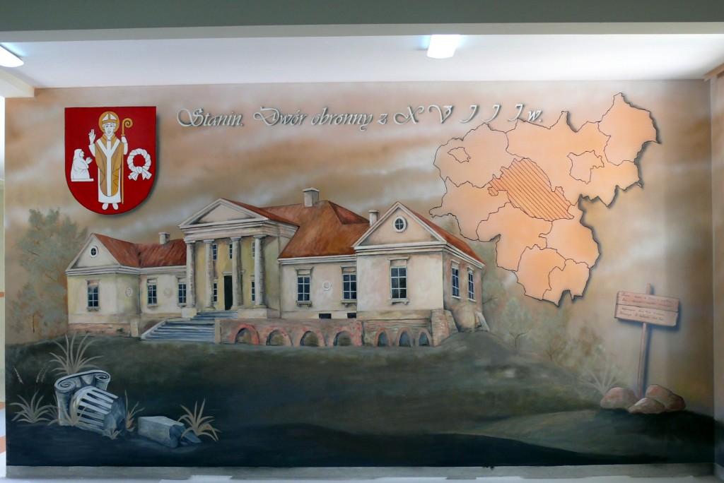 Herb gminy namalowany na scianie , malowanie napisów i loga