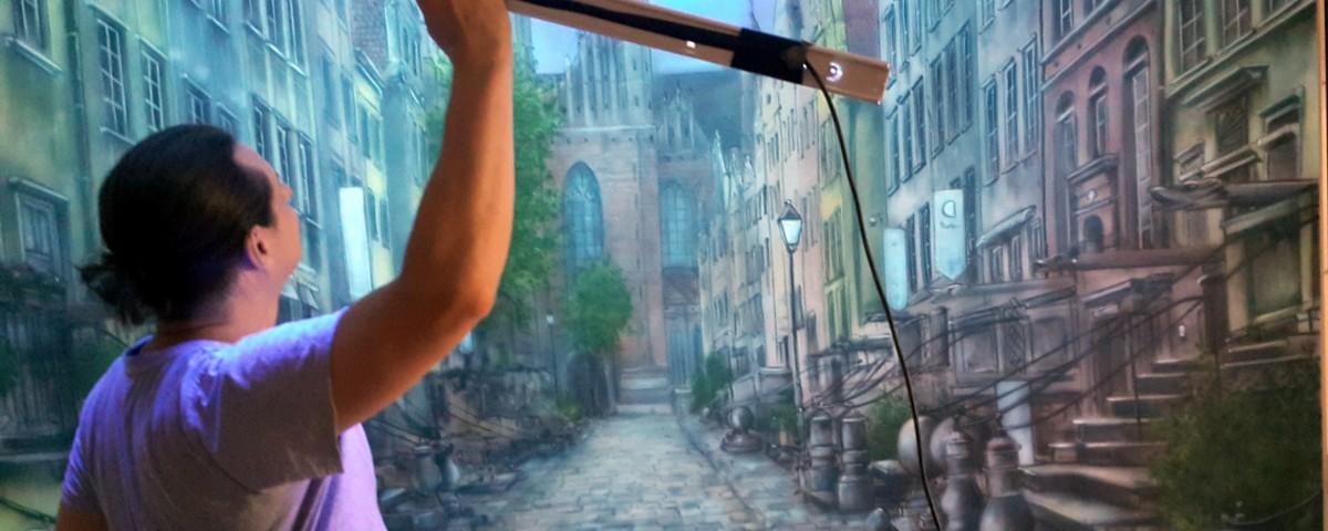 Malowanie na ścianie uliczki w perspektywie