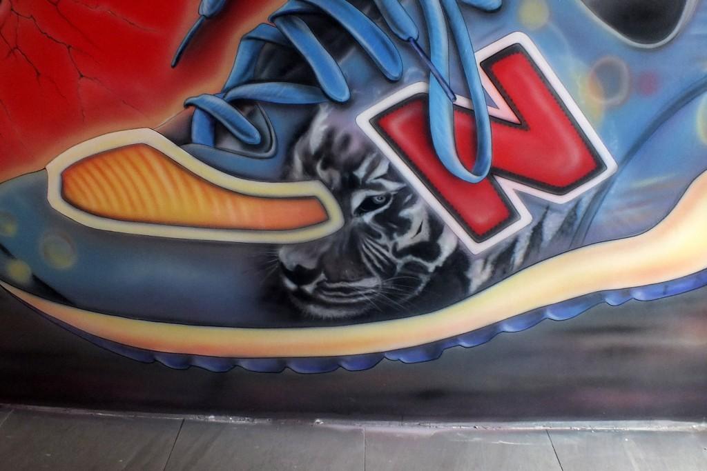 Profesjonalne malowanie reklam na ściani ePoznań, malowanie szyldów, loga malowane na elewacji