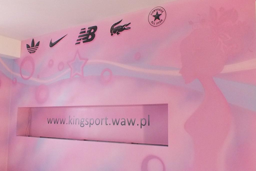 Malowanie loga i grafik na ścianieszyldu na ścianie