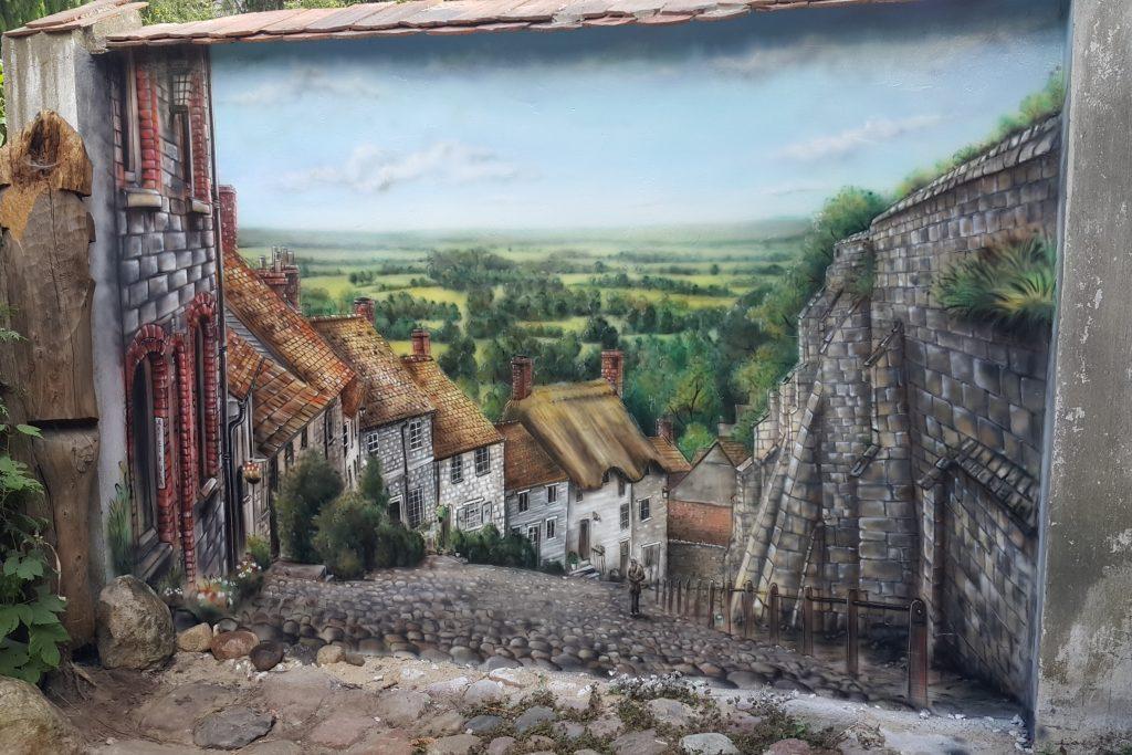 Malowanie grafik na ścianie, uliczka w perspektywie obraz 3D
