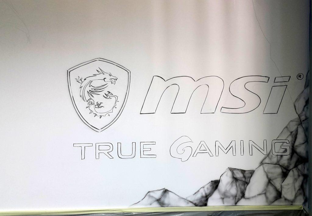 Malowanie logotypu na ścianie, ręcznie malowana reklama