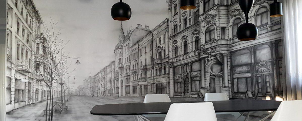 Malowanie uliczki w perspektywie, czarno-biały obraz namalowany na ścianie