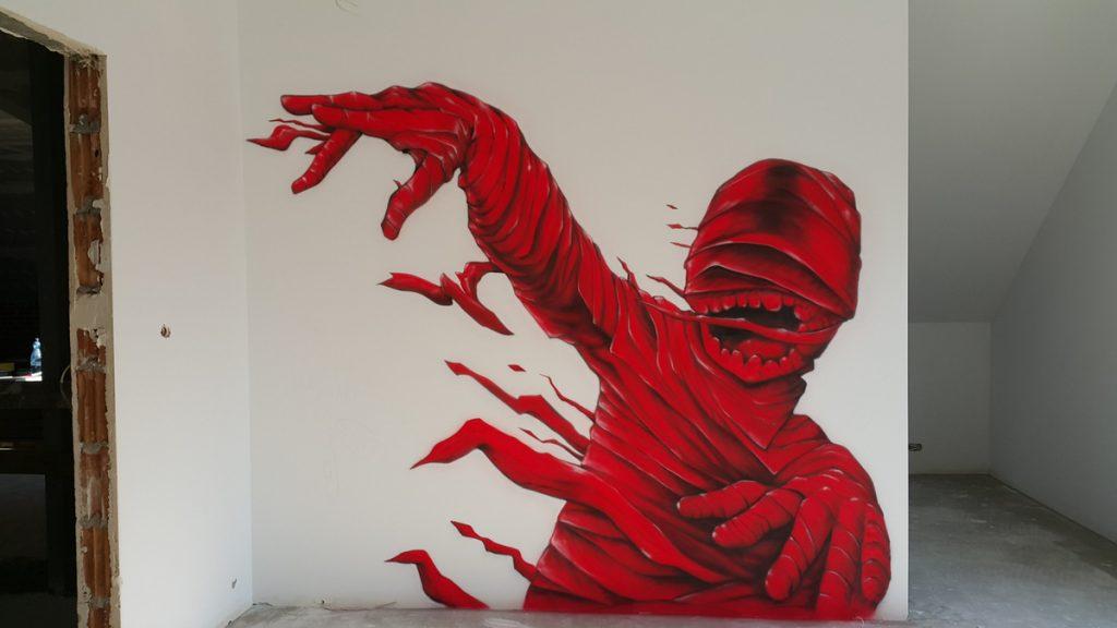 Malowanie pokoju młodzieżowego, mural 3D, czerwona mumia graffiti na ścianie w pokoju chłopca