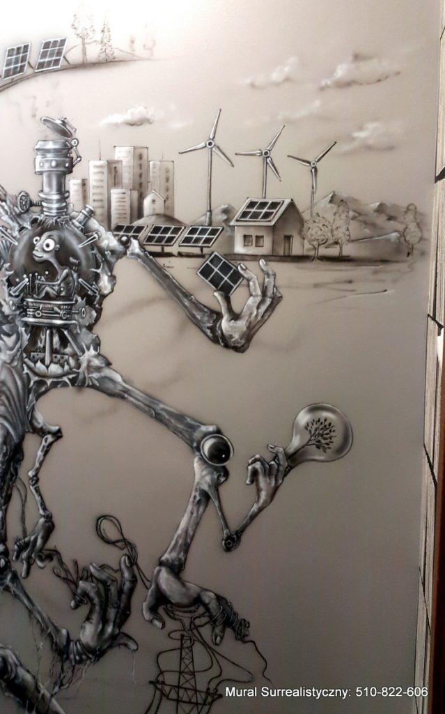 Malowanie obrazu w czarno bieli, mural na klatce schodoewej