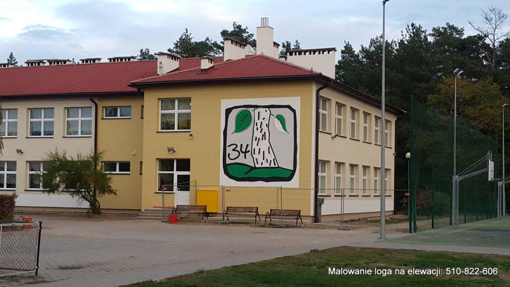 Malowane logotypów na elewacjach budynków, logo na elewacji szkolnej