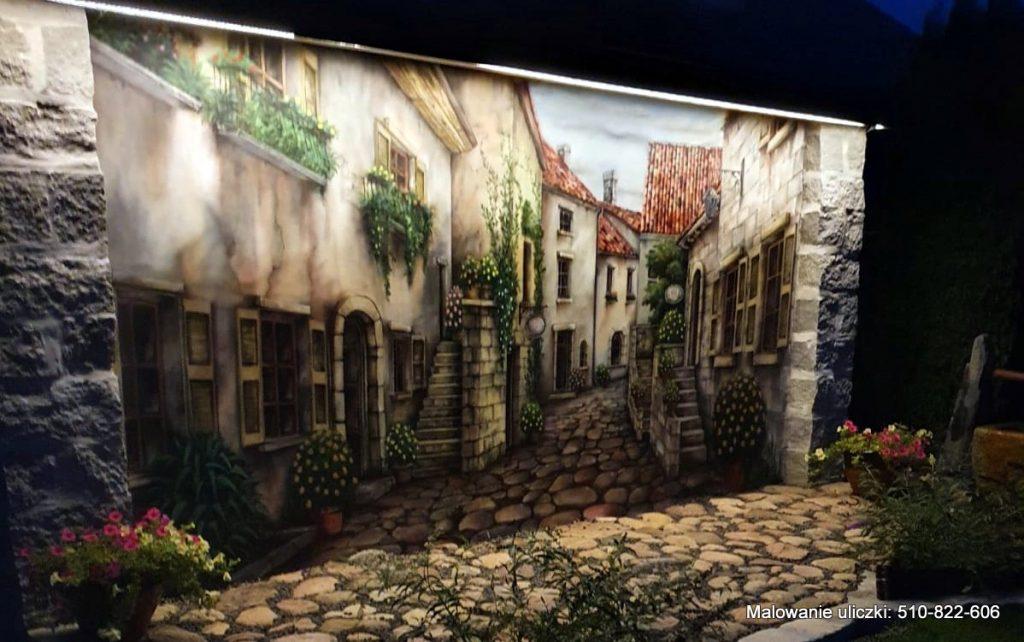 Podswietlone malowidło ścienne, mural w ogrodzie