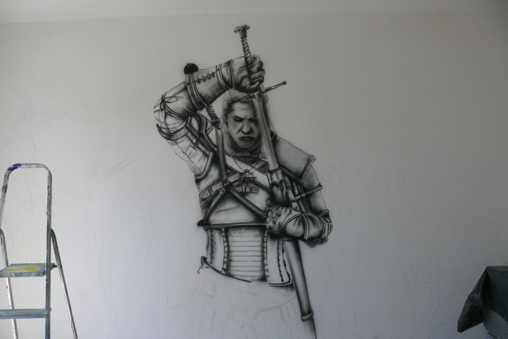 Malowanie wiedźmina na ścianie w pokoju młodziżowym