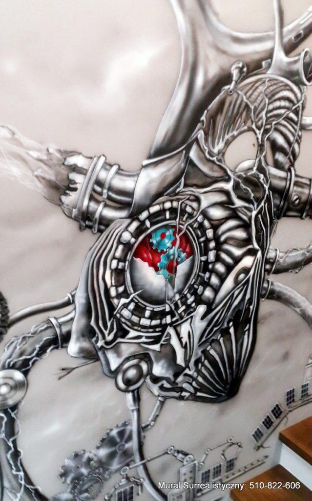 Czarno biały mural na klatce schodowej, biomachaniczne serca