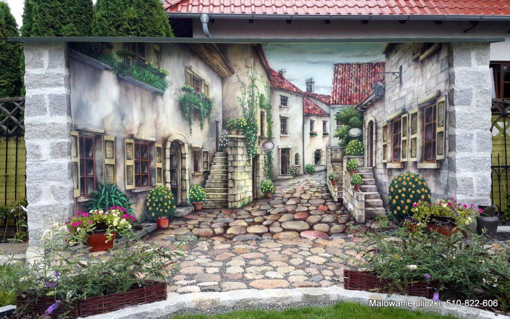 Malowanie obrazu na ścianie w ogrodzie