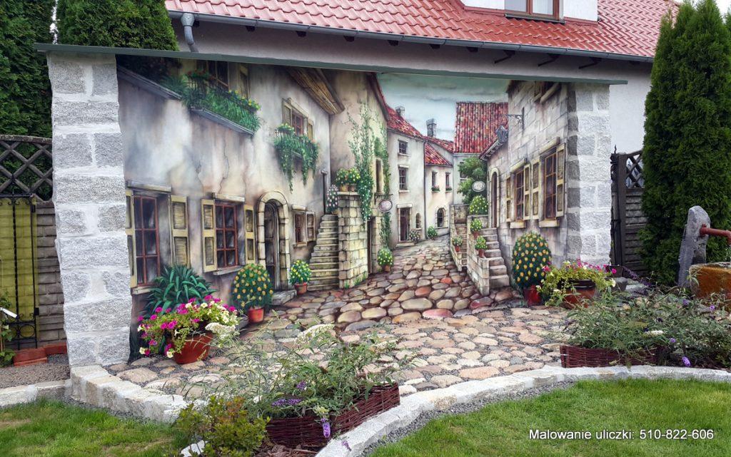 Malowanie muralu w ogrodzie,